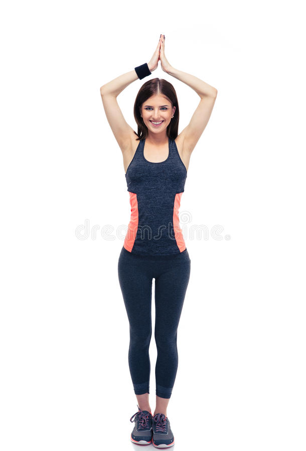 Happy fitness woman doing yoga excersise stock photography