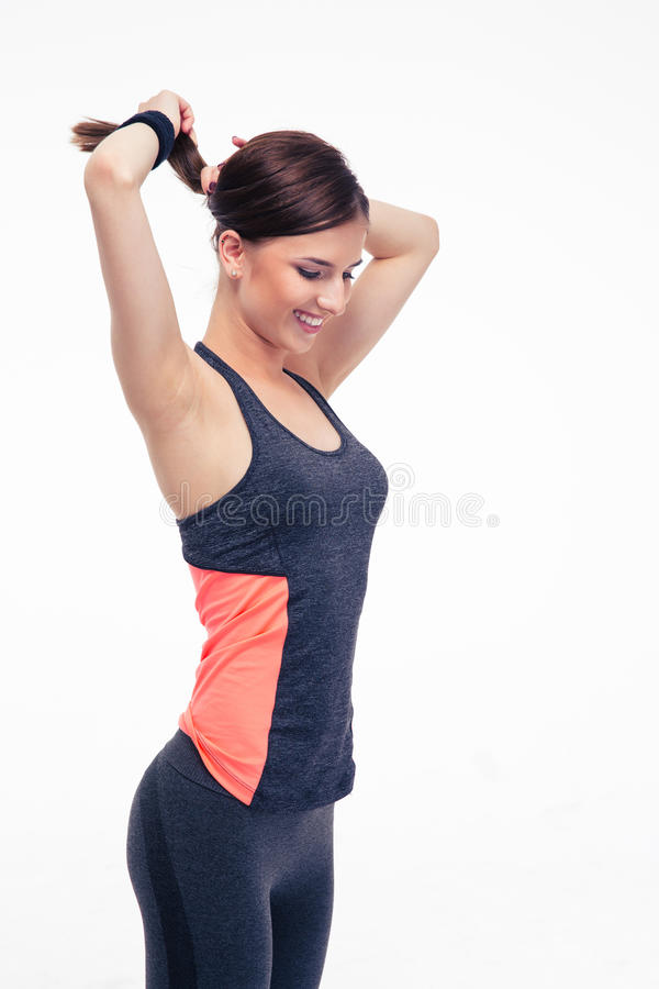 Happy fitness woman holding her hair in ponytail royalty free stock images