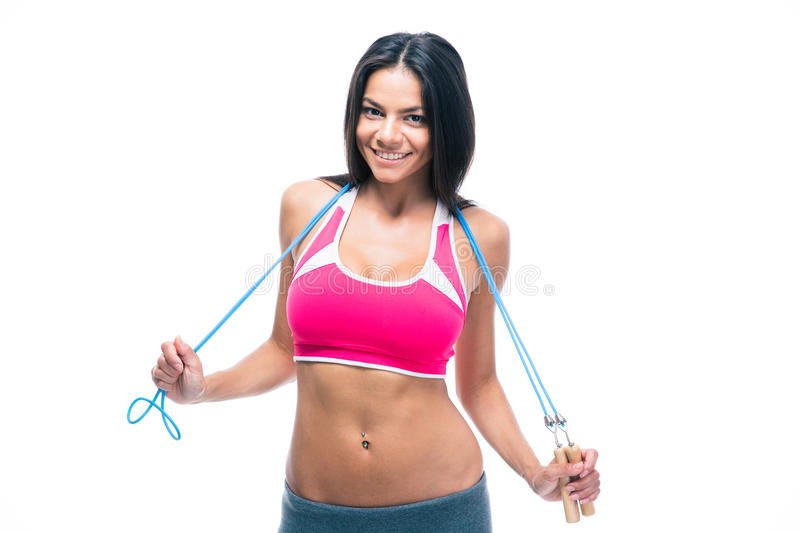 Happy fitness woman holding skipping rope. Isolated on a white background stock images