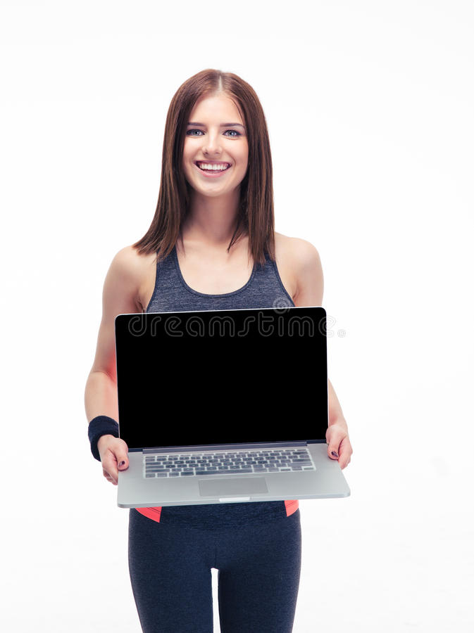 Happy fitness woman showing laptop screen. Happy fitness woman showing blank laptop screen isolated on a white background. Looking at camera royalty free stock photos