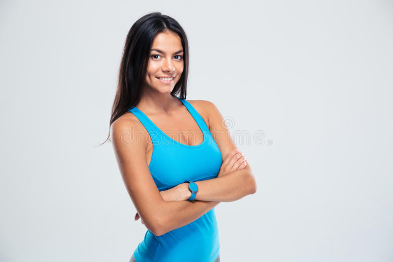 Happy fitness woman standing with arms folded stock photo