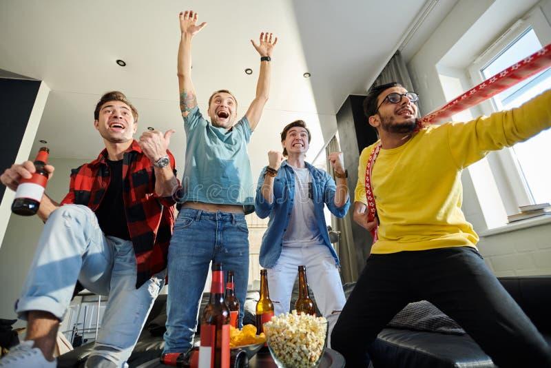 Happy football fans stock image