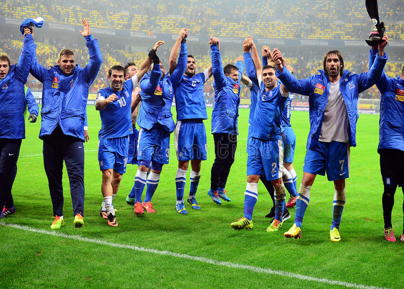 Happy football players celebrate qualifying to FIFA World Cup 2014 royalty free stock photos