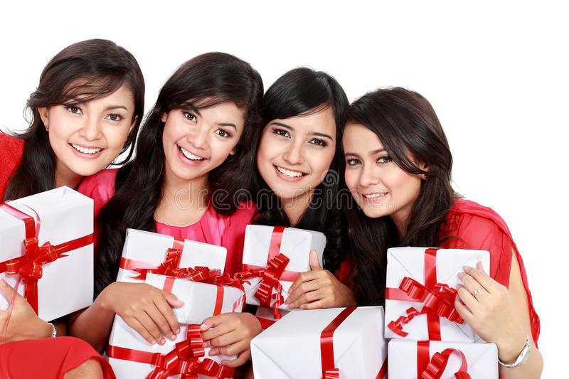 Happy four asian woman with christmas santa hat holding gift box royalty free stock images