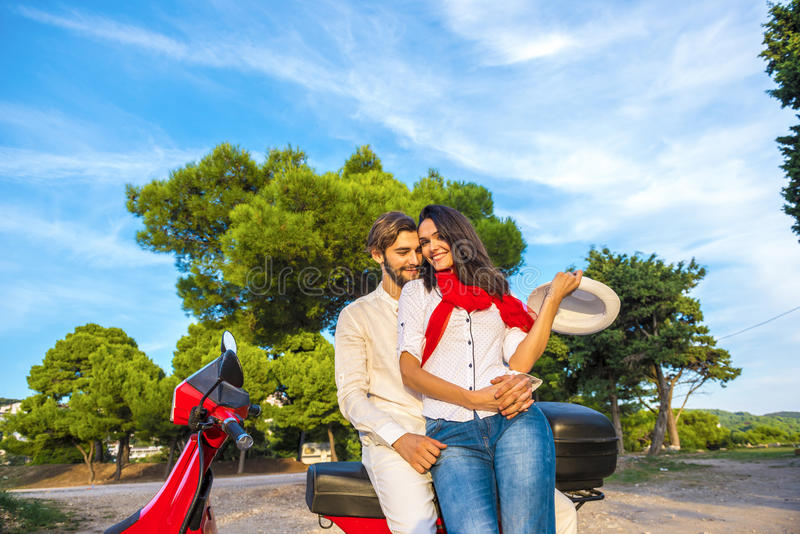 Happy free freedom couple driving scooter excited on summer holidays vacation. stock images