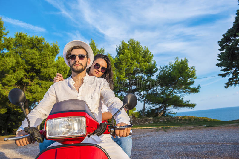 Happy free freedom couple driving scooter excited on summer holidays vacation. royalty free stock photos
