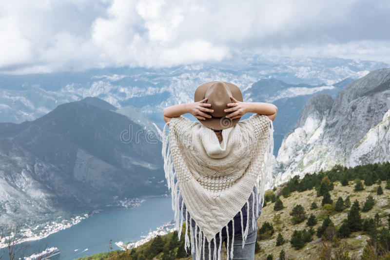 Happy free woman enjoying trip adventure travel with folk hat sh. Happy free woman enjoying trip adventure travel with open arms up showing freedom in mountain stock images