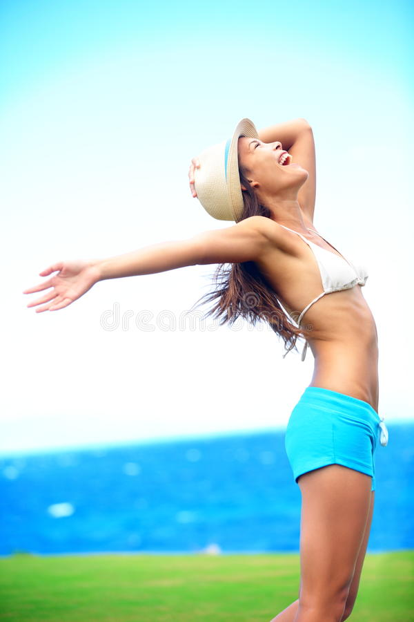 Happy freedom woman in summer stock photo