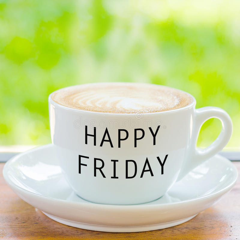 Happy Friday on coffee cup. Over natural background stock photography