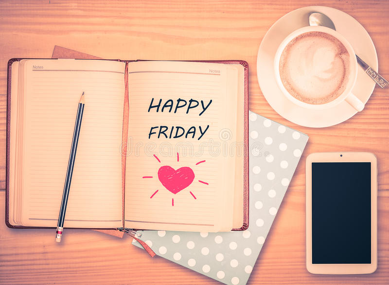 Happy Friday on notebook , pencil, smart phone and coffee cup stock photos