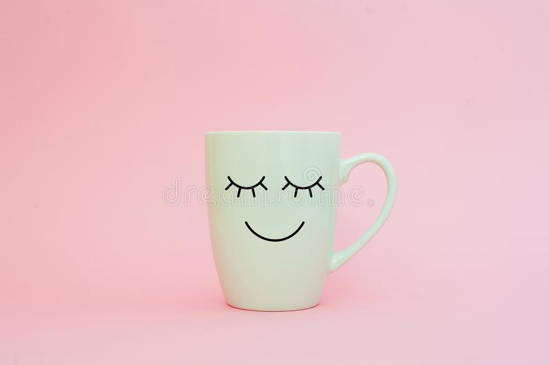 Happy friday word. Cup of coffee on pink background with smile face on mug. Concept about love and relationship. royalty free stock photography