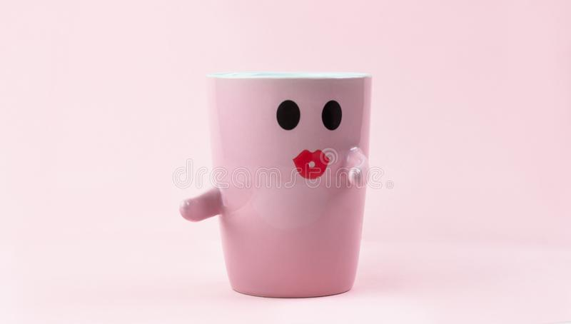 Happy friday word. Cup of coffee on pink background with smile face on mug. Concept about love and relationship. stock images