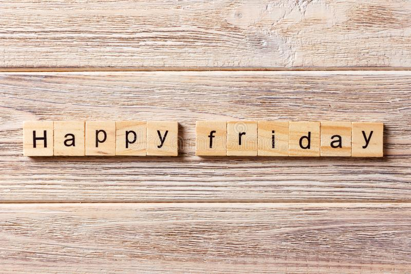 Happy Friday word written on wood block. Happy Friday text on table, concept royalty free stock photo