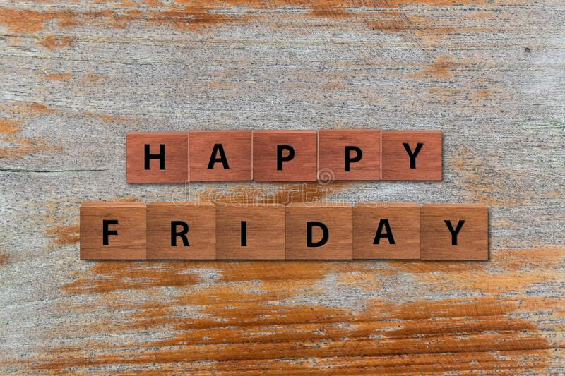 Happy Friday word written on wood block. Happy Friday text on wooden table for your design, concept stock image
