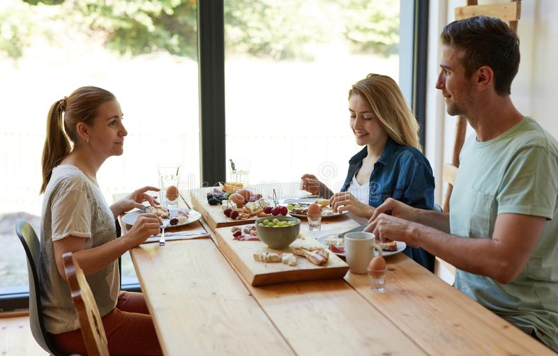 Happy friend eating together stock images