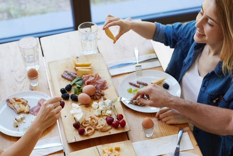 Happy friend eating together stock photography