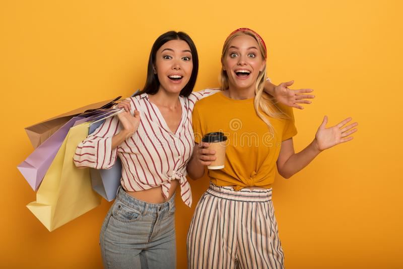 Happy friend girls are amazed about a shop sales. surprised expression. Happy friend girls are amazed about a shop sales. surprised and emotional expression royalty free stock photography