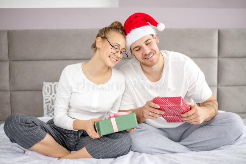 Happy friendly family holding gifts and enjoying spending time together stock photography