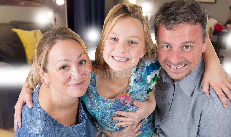 Happy friendly family at home mother father and beauty daughter blonde stock image