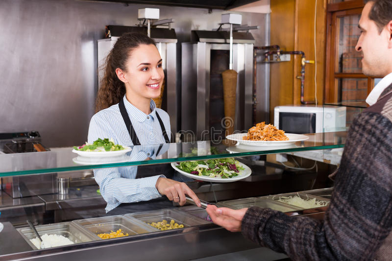 Happy friendly female worker serving customer stock photos
