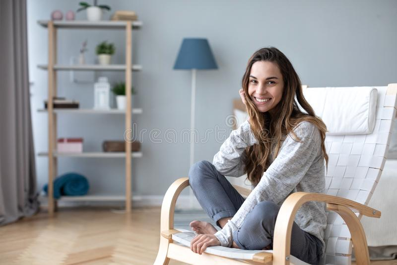 Happy friendly woman posing indoor at home in casual clothes stock images