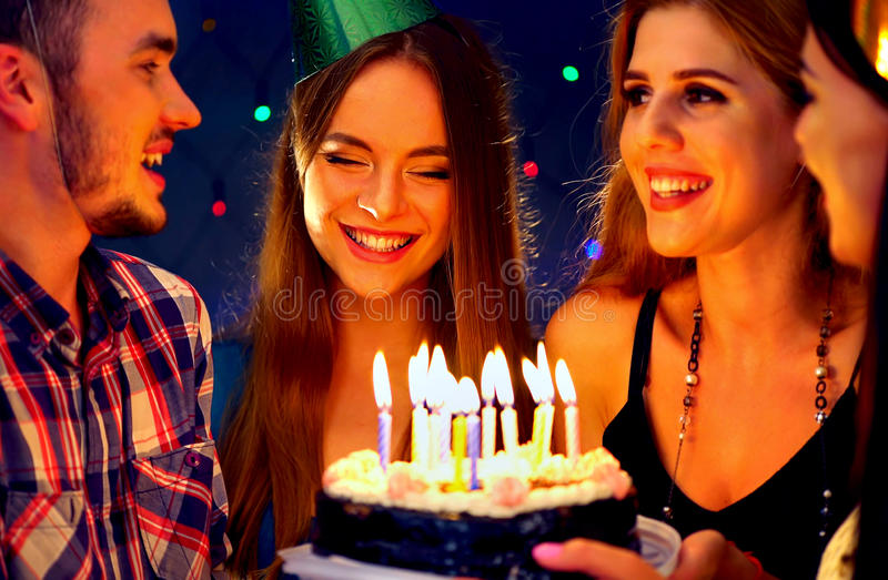 Happy friends birthday party with candle celebration cakes. Happy friends birthday celebrating food with celebration cakes. Meet four people wear in hat party stock photography