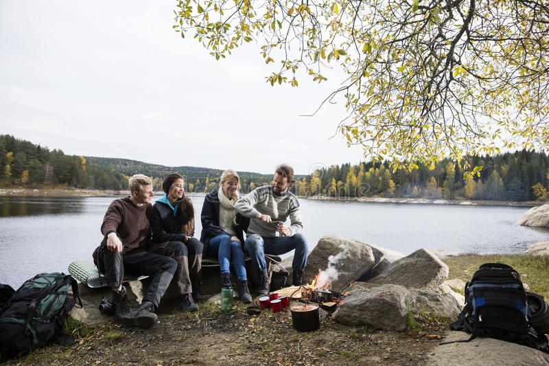 Happy Friends Camping On Lakeshore royalty free stock photography