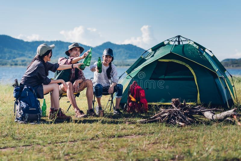 Happy friends in camping party having fun together and drinking. On holiday summer royalty free stock images