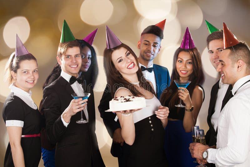 Happy friends celebrating birthday at nightclub. Portrait of happy young women celebrating birthday with friends at nightclub royalty free stock photos