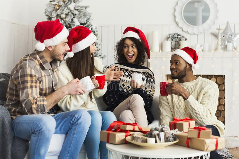 Happy friends celebrating Christmas at home stock photos