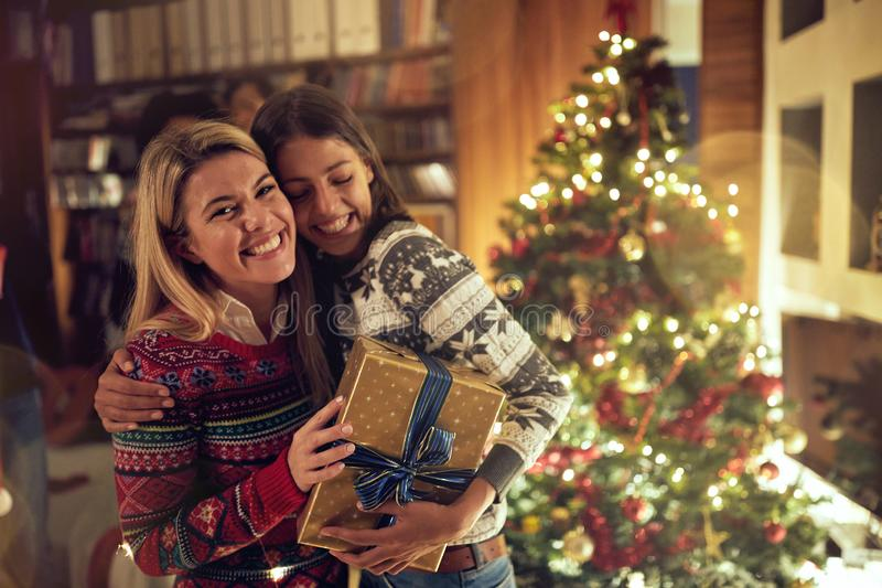 .happy friends celebrating Christmas together stock images