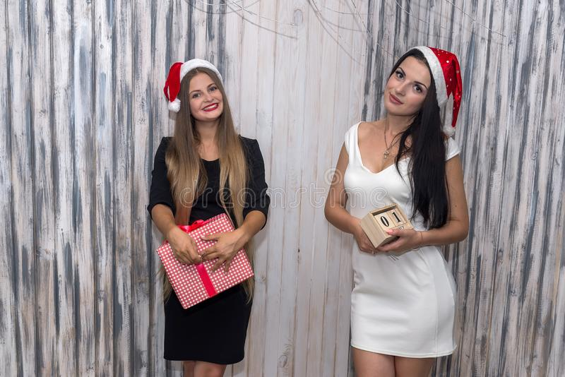 Happy friends celebrating new year with gift box stock image