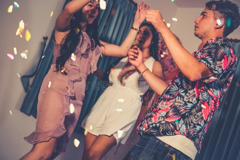 Happy friends dancing and having fun in New year party at night club. Event celebration and anniversary concept. People lifestyles stock photography