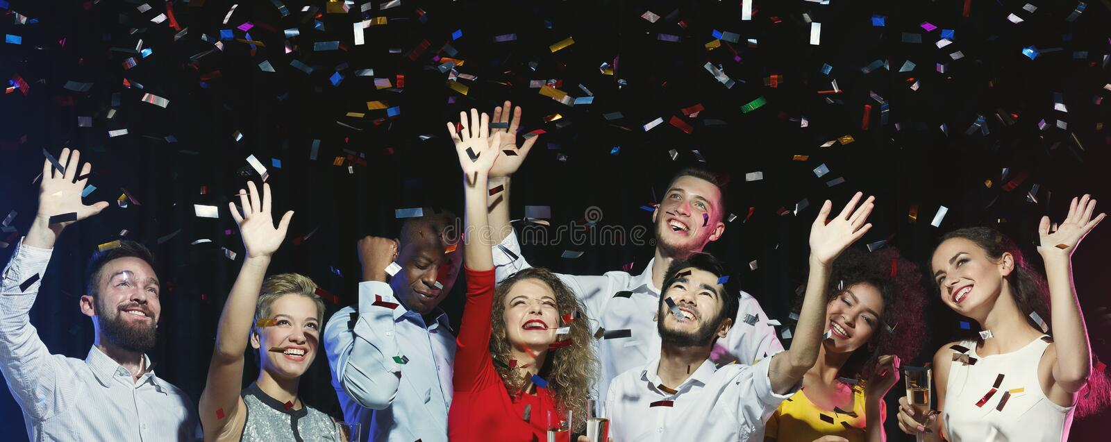 Happy friends dancing at New Year party stock photography