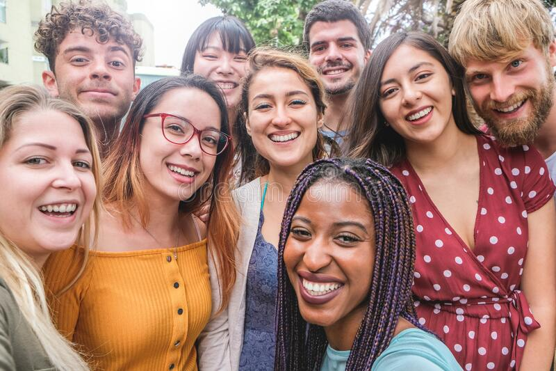 Happy friends from diverse cultures and races taking photo making funny faces - Millennial generation and friendship concept with. Young people having fun stock images