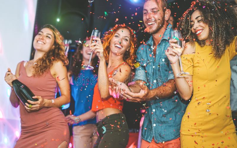 Happy friends doing party drinking champagne and dancing in the club - Millennials young people having fun celebrating royalty free stock photos