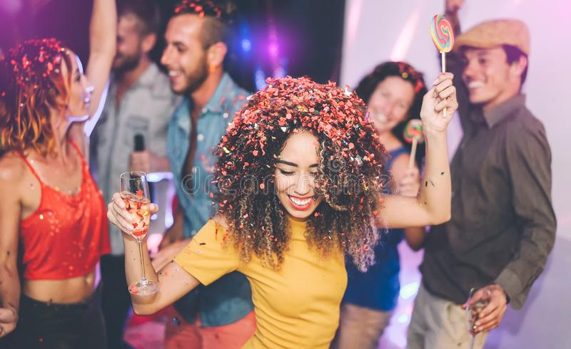 Happy friends doing party drinking champagne in nightclub - Group young people having fun celebrating new year holidays together royalty free stock images