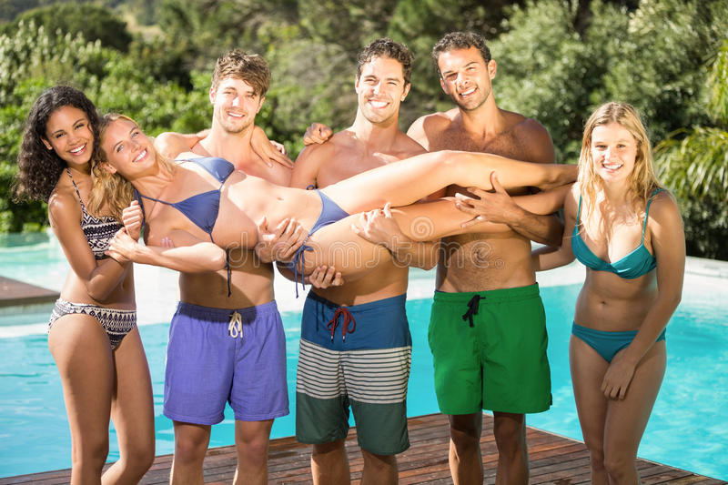 Happy friends enjoying at the swimming pool royalty free stock photo