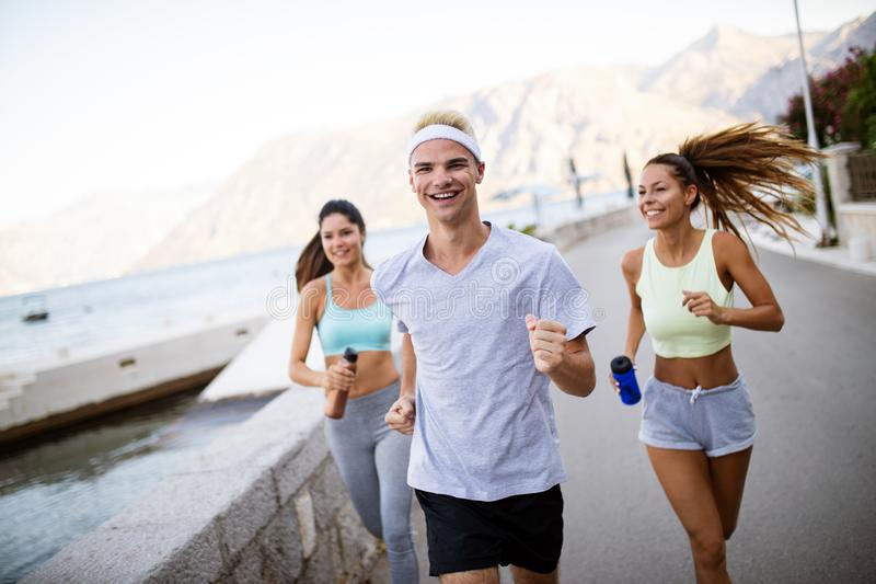 Friends fitness training together outdoors living active healthy stock images