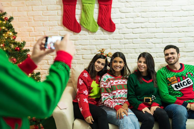 Happy Friends Getting Clicked During Christmas Celebrations stock images