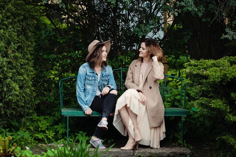 Happy friends girls chatting in spring park, lifestyle portrait royalty free stock images