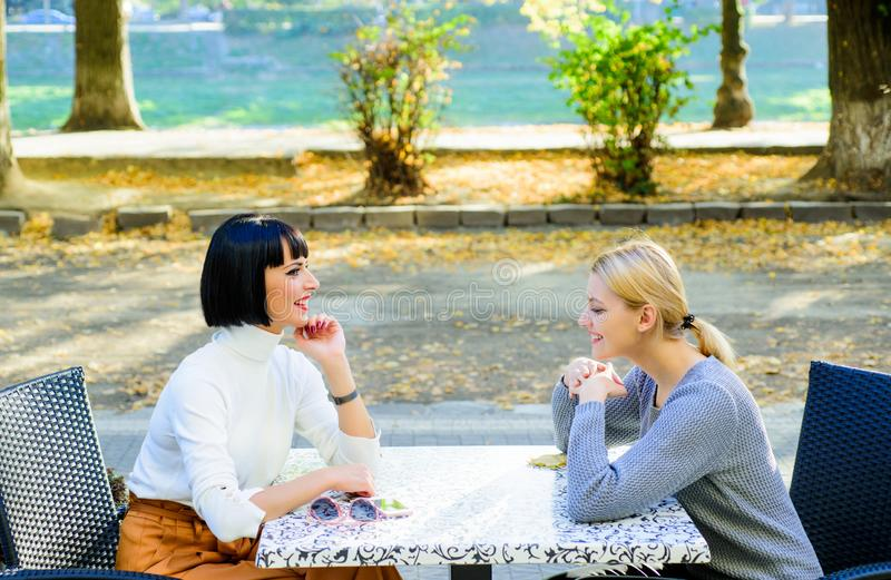 Happy friends girls spend time in cafe. real female frienship. family bonding sisterhood. bisiness meeting. free time. With joy. cafe terrace. happy breakfast stock photo