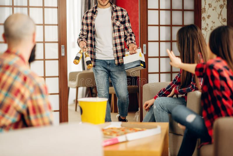 Happy friends going to drink a beer at home party. Happy friends going to drink a beer at the home party. Good friendship, group of people leisures royalty free stock image