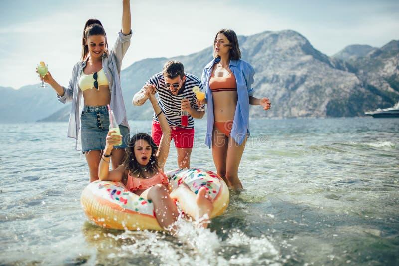 Friends having fun on beach stock photo