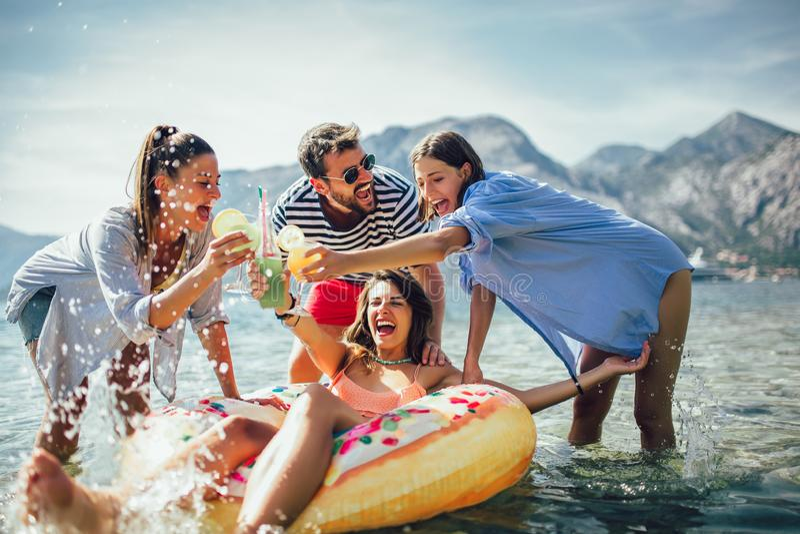 Friends having fun on beach stock image