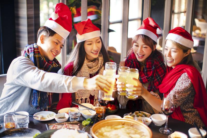 Happy friends having fun and celebrating christmas in hot pot stock photos