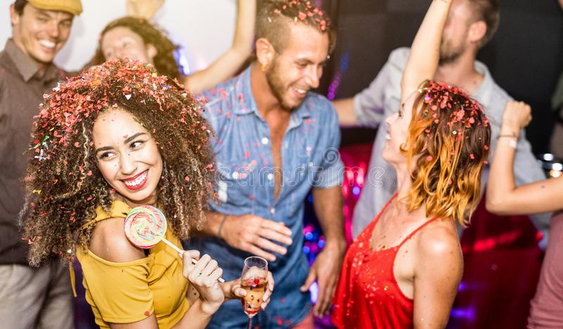 Happy friends having fun and dancing at party night club stock photo