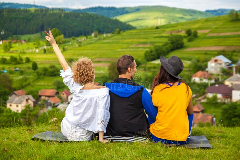 Happy friends having fun on the hill enjoying recreation and talking,horizontal. royalty free stock photography