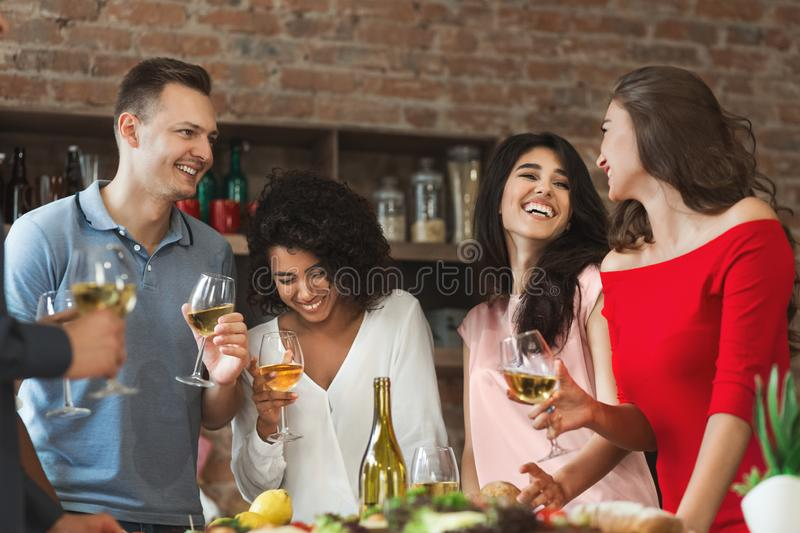 Happy friends having fun at home party stock images