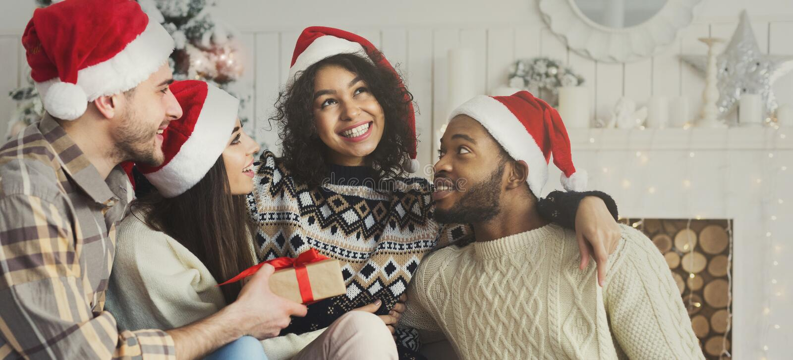 Happy friends having fun near new year tree stock images